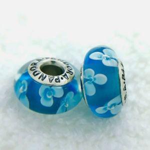 Pandora pair of sea blue flower Muranos.